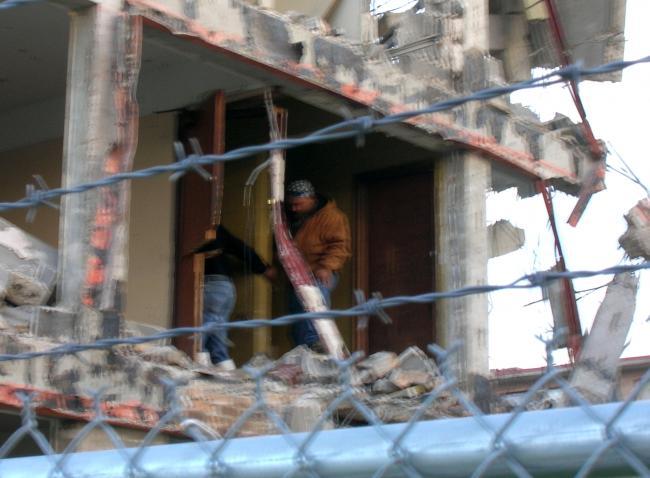 Demolition crew sear...